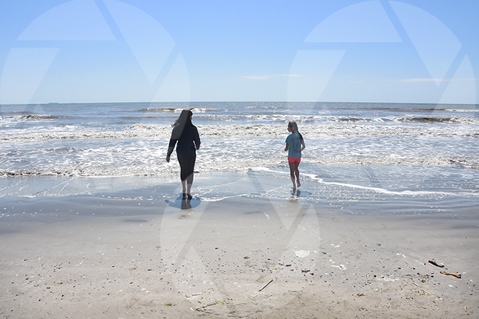Sisters on a sunny Galveston Beach