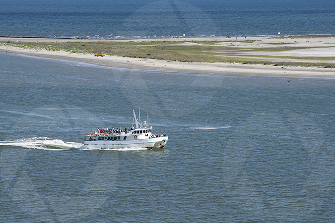 Image of a tour catamaran near the northeast end of Galveston Island