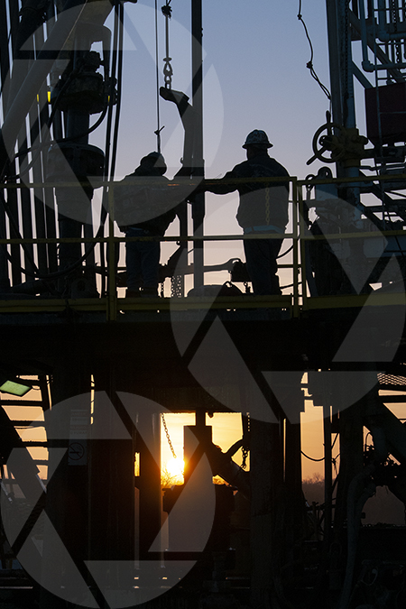 Image of an oil rig floor at sunset