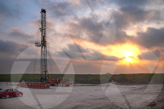 Picture of a workover oil rig just before sunset