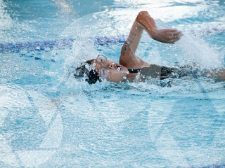 Photo of a female child swimming freestyle