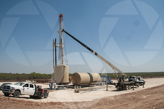Oilfield picture of ongoing work at a well pad.